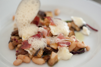 Mushrooms and white beans with sautéed beetroot leaves, crotin, coppa and topped with a sauce soubise