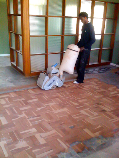 Sanding the newly laid flooring